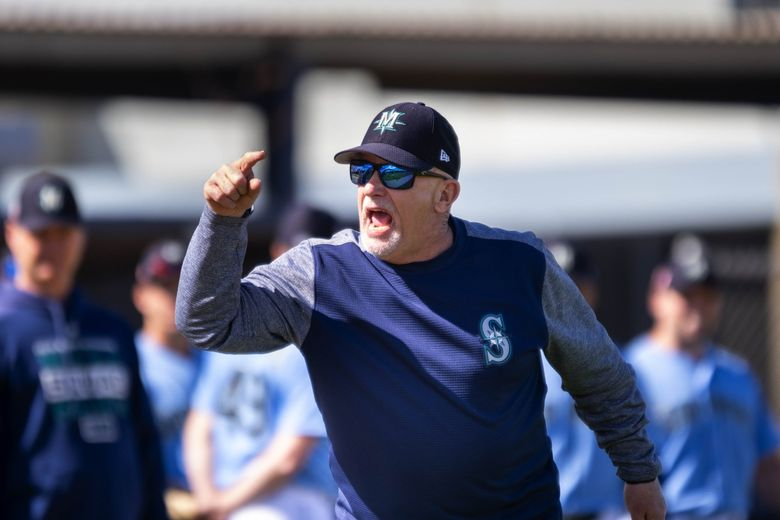Mariner first base/infield coach Perry Hill, running the team through infield drills last spring, will be one of three Seattle coaches to work remotely this season.  (Dean Rutz / The Seattle Times)
