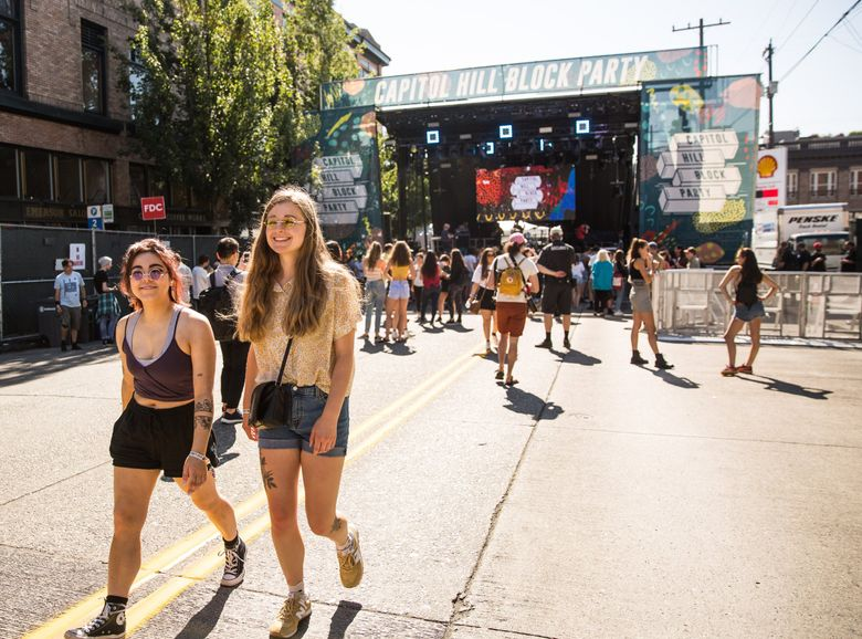 Paige Dobbs (left) and Jess Lezniak walk away from the main stage after a performance at the Capitol Hill Block Party, on Friday, July 20, 2018. (Rebekah Welch / The Seattle Times)