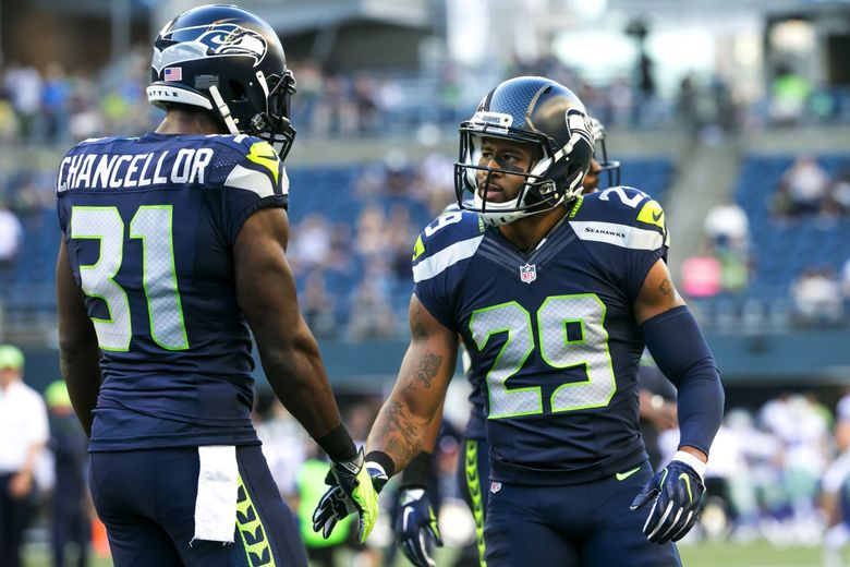 Kam Chancellor and Earl Thomas shake hands before a game in 2016. (Bettina Hansen / The Seattle Times)