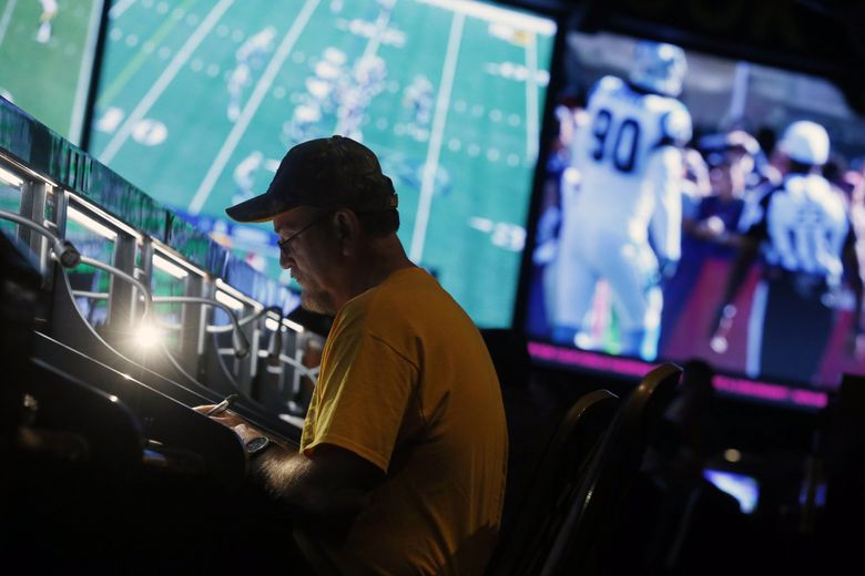 A bettor on Oct. 1, 2017, at the Westgate SuperBook in Las Vegas. Could sports gambling be on the way in Washington state? (Isaac Brekken / The New York Times)