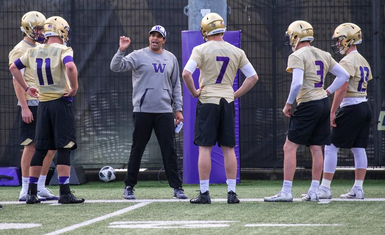Offensive coordinator Bush Hamdan works with the Huskies' quarterbacks on the first day of spring practice in 2018. (Mike Siegel / The Seattle Times)