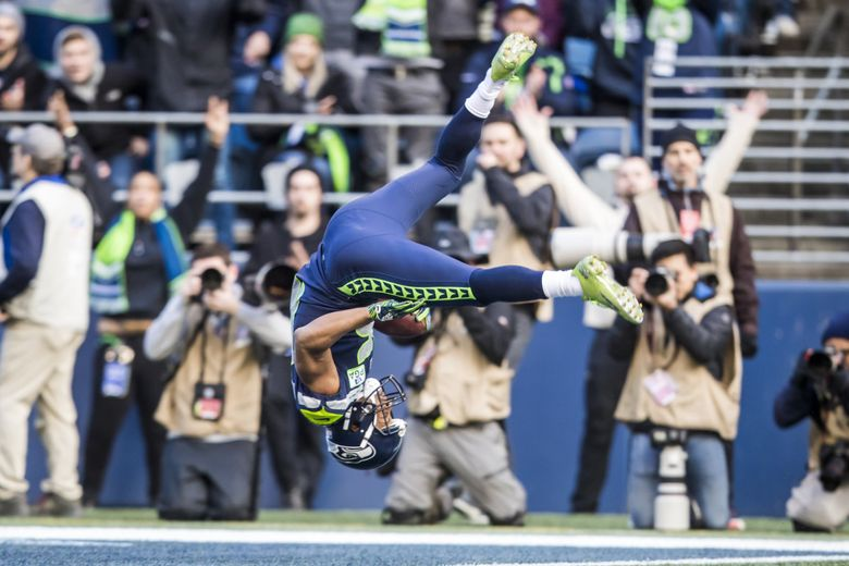 Seahawks wide receiver Tyler Lockett does a flip into the end zone for a 29-yard touchdown against the Cardinals in December. (Bettina Hansen / The Seattle Times)