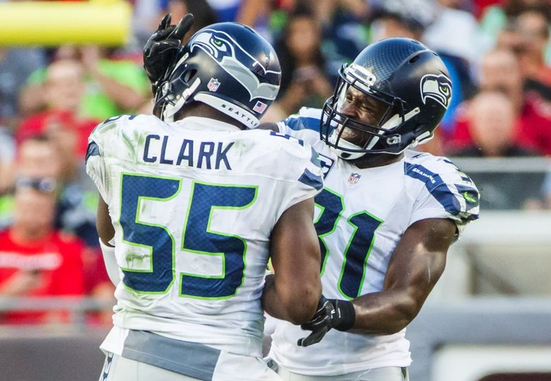 Seahawks strong safety Kam Chancellor and defensive end Frank Clark.  (Bettina Hansen / The Seattle Times)