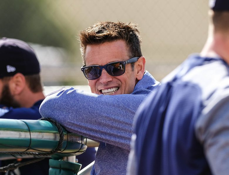 Mariners general manager Jerry Dipoto watches players in the batting cage at spring training Sunday, February 17. (Dean Rutz / The Seattle Times)