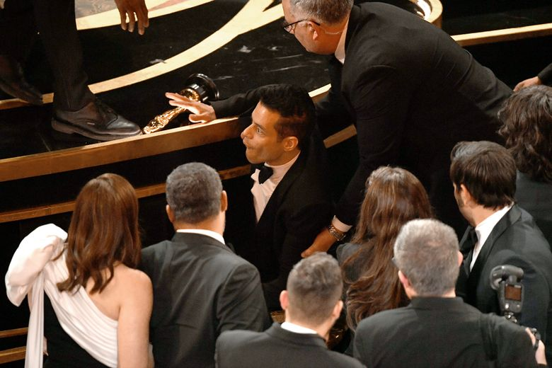 Rami Malek takes a tumble while attending the 91st Annual Academy Awards at the Dolby Theatre in Hollywood on Sunday.  (Kevin Winter / Getty Images)