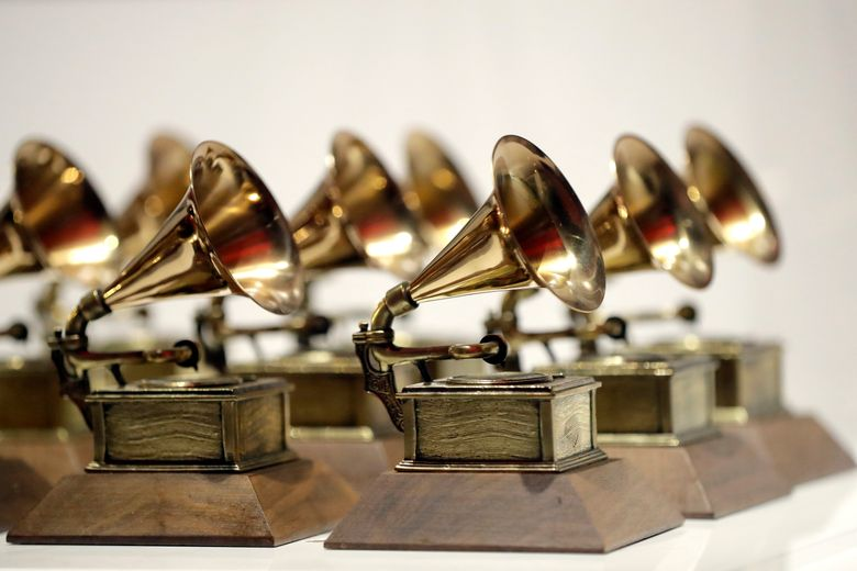 """FILE – In this Oct. 10, 2017, file photo, various Grammy Awards are displayed at the Grammy Museum Experience at Prudential Center in Newark, N.J. When the Grammys added more nominees to its top four categories, the Recording Academy said in a statement last year that the expansion from five to eight nominees would add more """"flexibility"""" for voters. But for those artists competing in the night's biggest awards, the change made it a little harder for any one nominee to win, statistically speaking. (AP Photo/Julio Cortez, File)"""