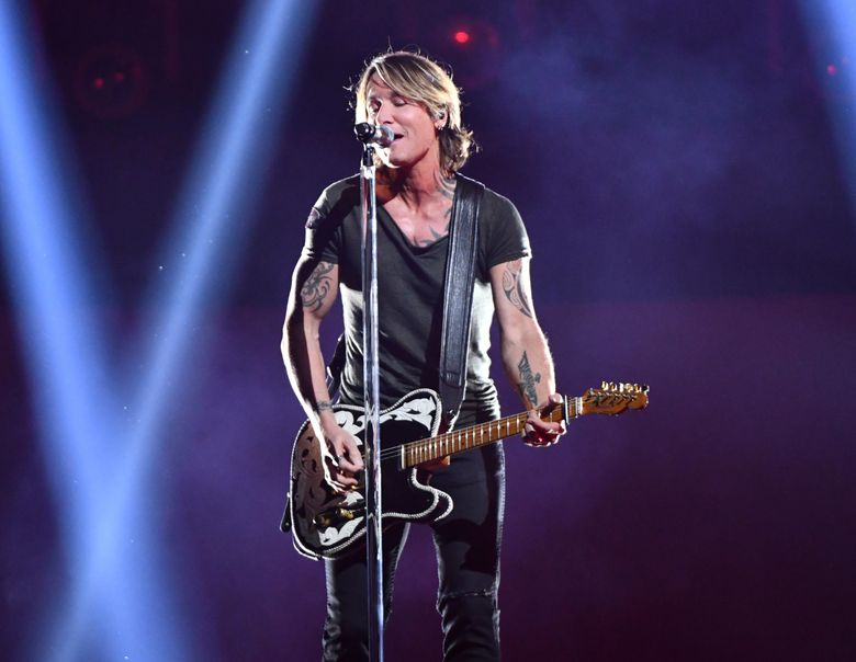 FILE – In this Nov. 14, 2018, file photo, Country music star Keith Urban performs at the 52nd annual CMA Awards at Bridgestone Arena in Nashville, Tenn. Urban will perform at the NHL's Stadium Series outdoor game in Philadelphia between the Penguins and Flyers on Feb. 23. (Photo by Charles Sykes/Invision/AP, File)