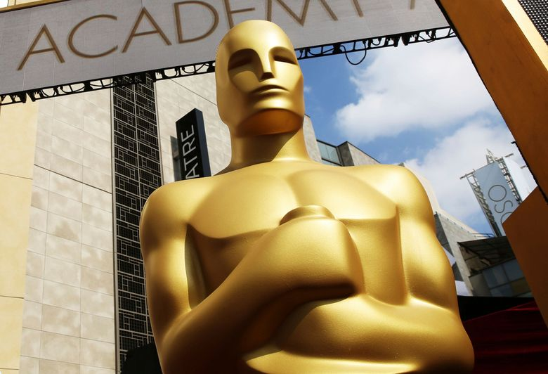 FILE – In this Feb. 21, 2015, file photo, an Oscar statue appears outside the Dolby Theatre for the 87th Academy Awards in Los Angeles. The Academy Awards this year have a record number of female nominees, but women are still lagging behind in the top categories. In the 20 non-gendered categories, 52 women are nominated, up eight from last year. Yet there are no female nominees for directing, cinematography, editing, score or visual effects. And overall, men make up over 75 percent of this year's Oscar nominees. (Photo by Matt Sayles/Invision/AP, File)