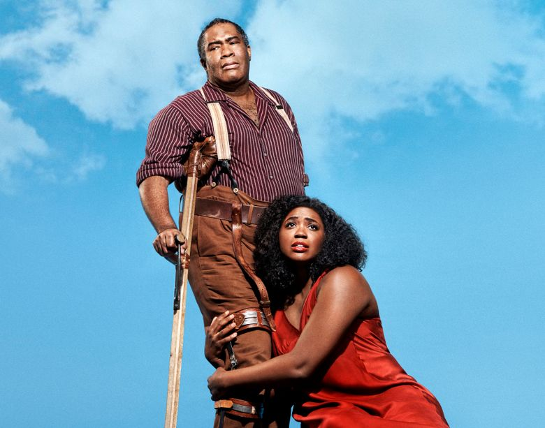 """This undated image released by the Metropolitan Opera shows Eric Owens as Porgy, left, and Angel Blue as Bess in the Gershwins' """"Porgy and Bess."""" The Metropolitan Opera will hire an all-black outside chorus next season for its first presentation in nearly three decades of the Gershwins' """"Porgy and Bess,"""" which opens the season on Sept. 23. (Paola Kudacki/Metropolitan Opera via AP)"""