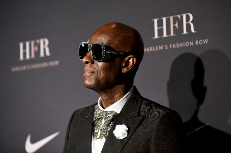 """FILE- In this Sept. 4, 2018, file photo Honoree and fashion icon Dapper Dan attends a fashion show and awards ceremony held by the Harlem Fashion Row collective and Nike before the start of New York Fashion Week. Fashion collaborator Daniel """"Dapper Dan"""" Day is seeking accountability as other celebrities call for boycotts of Gucci after the fashion house apologized for producing a sweater that was compared to blackface. The Harlem-based designer posted on Instagram Sunday, Feb. 10, 2019, that he is a """"Black man before I am a brand."""" He wrote, """"another fashion house has gotten it outrageously wrong. There is no excuse or apology that can erase this kind of insult."""" (AP Photo/Diane Bondareff, File)"""