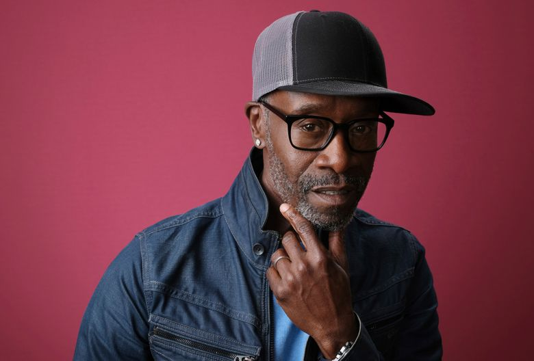"""FILE- In this Jan. 31, 2019, file photo Don Cheadle, a cast member in the Showtime series """"Black Monday,"""" poses for a portrait during the 2019 Winter Television Critics Association Press Tour in Pasadena, Calif. On Saturday, Feb. 16, Cheadle delivered some political messages along with jokes as he hosted """"Saturday Night Live"""" for the first time. (Photo by Chris Pizzello/Invision/AP, File)"""
