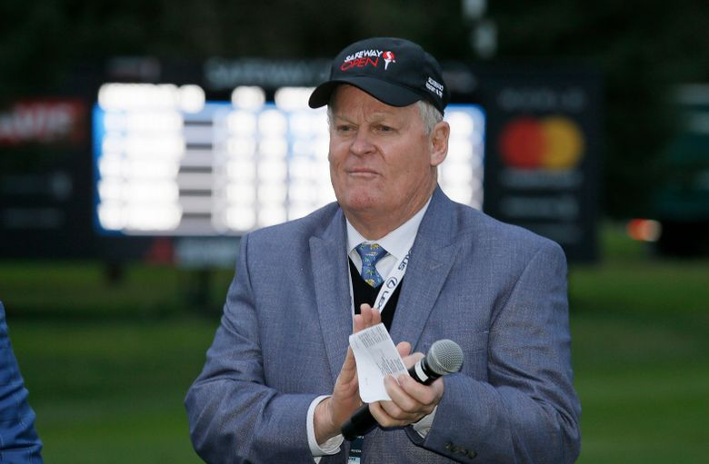"""FILE – In this Oct. 16, 2016, file photo, Johnny Miller stands on the 18th green of the Silverado Resort North Course during the trophy presentation of the Safeway Open PGA golf tournament in Napa, Calif. Miller will climb into the booth at No. 18 for the final time on Saturday, calling the action for the third round of the Phoenix Open before hanging up his headset. The 71-year-old is walking away to spend more time with his family and picked the Phoenix Open for his finale because of his affinity for the tournament where he won twice and earned the nickname the """"Desert Fox."""" (AP Photo/Eric Risberg, File)"""
