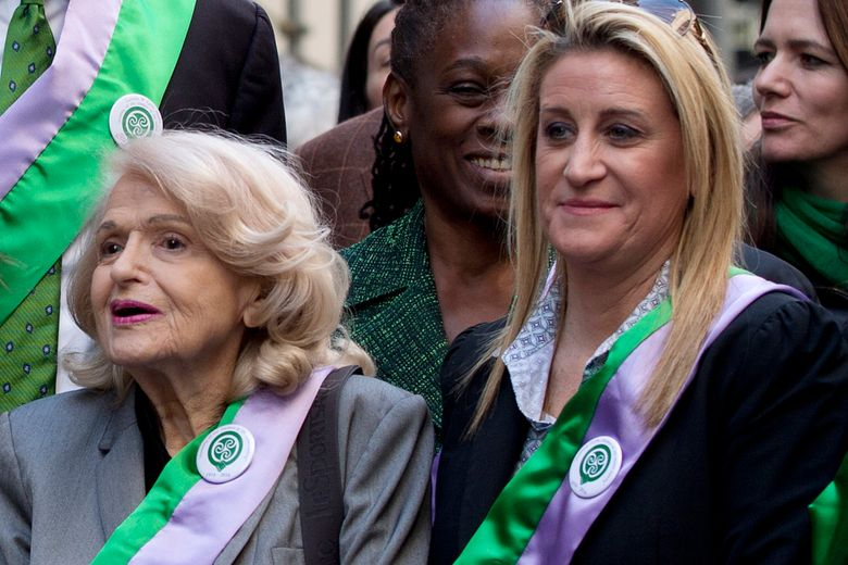 """FILE – In this March 17, 2016, file photo, gay rights pioneer Edie Windsor, left, and her spouse, Judith Kasen-Windsor, participate in the St. Patrick's Day parade in New York. A posthumous memoir by Windsor entitled """"A Wild and Precious Life"""" will be released in October, St. Martin's Press announced on Thursday, Feb. 28, 2019. (AP Photo/Mary Altaffer, File)"""