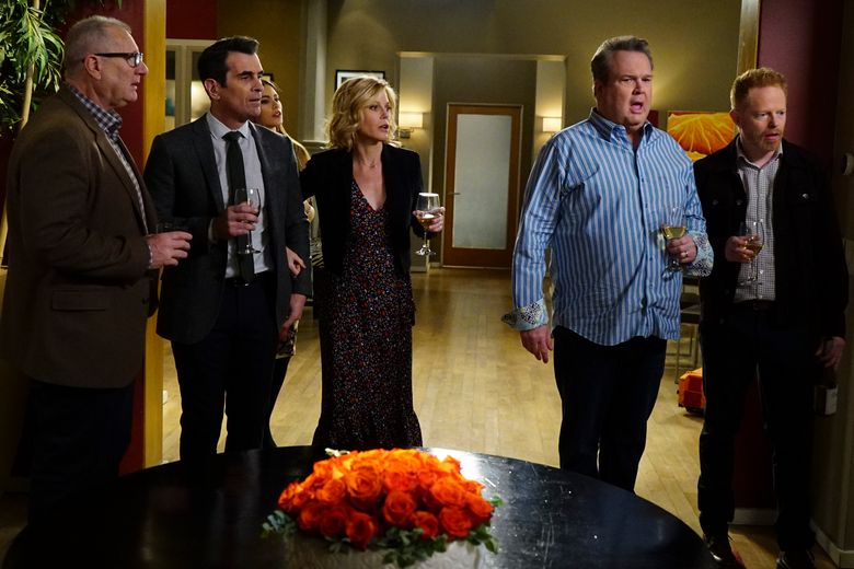 """This image released by ABC shows, from left, Ed O'Neill, Ty Burrell, Sofia Vergara, obscured, Julie Bowen, Eric Stonestreet and Jesse Tyler Ferguson in a scene from """"Modern Family."""" ABC's """"Modern Family,"""" the five-time Emmy Award winner for best comedy, will end its run next year after 11 seasons. ABC Entertainment President Karey Burke announced the end of the series about the boisterous extended family on Tuesday. (Richard Cartwright/ABC via AP)"""