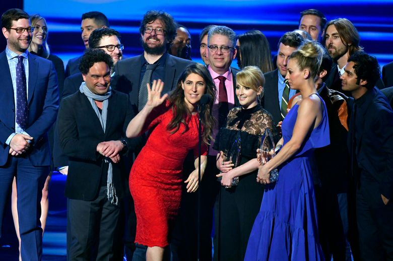"""FILE – In this Jan. 18, 2017 file photo, the cast and crew of """"The Big Bang Theory"""" accept the award for favorite network TV comedy at the People's Choice Awards at the Microsoft Theater in Los Angeles. Champagne is briefly replacing scripts on the set of """"The Big Bang Theory."""" A nondescript building on the sprawling Warner Brothers production lot in Burbank known as Stage 25 was renamed Thursday, Feb. 7, 2019, for the CBS sitcom that called it home for 12 years and will soon depart. (Photo by Vince Bucci/Invision/AP, File)"""