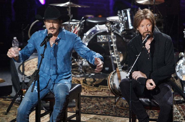 """FILe – In this Aug. 12, 2009 file photo, Kix Brooks, left, and Ronnie Dunn of the country music duo Brooks & Dunn, talk about their decision to stop performing together as they answer questions from the audience during a television taping in Nashville, Tenn. The Grammy-winning duo is getting back in the studio together for the first time in a decade to record collaborations with country music's brightest stars. The record called """"Reboot"""" includes classic Brooks & Dunn hits sung with artists like Musgraves and Combs, as well as Kane Brown, Thomas Rhett, Brothers Osborne, Ashley McBryde and more.  (AP Photo/Mark Humphrey)"""
