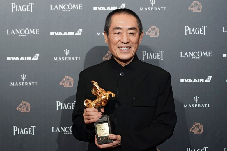 """FILE – In this Saturday, Nov. 17, 2018, file photo, Chinese director Zhang Yimou holds his award for Best Director at the 55th Golden Horse Awards in Taipei, Taiwan. The latest film from Zhang has been dropped from the Berlin International Film Festival for """"technical reasons."""" A notice on the official account of the movie """"One Second"""" on China's Weibo microblogging service apologized, but gave no details other than to say it was not possible to show the film at Berlin. (AP Photo/Billy Dai, File)"""