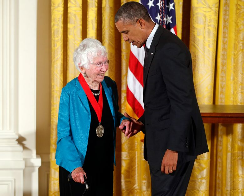 """FILE – In this July 28, 2014 file photo President Barack Obama awards the 2013 National Humanities Medal to historian Anne Firor Scott from Chapel Hill, N.C., during a ceremony in the East Room at the White House in Washington. Anne Firor Scott, a prize-winning historian and esteemed professor who upended the male-dominated field of Southern scholarship by pioneering the study of Southern women, has died. She was 97. Her death was announced last week by Duke University, where she taught for three decades. The citation for her humanities medal praised her """"groundbreaking research spanning ideology, race, and class."""" (AP Photo/Charles Dharapak, file)"""
