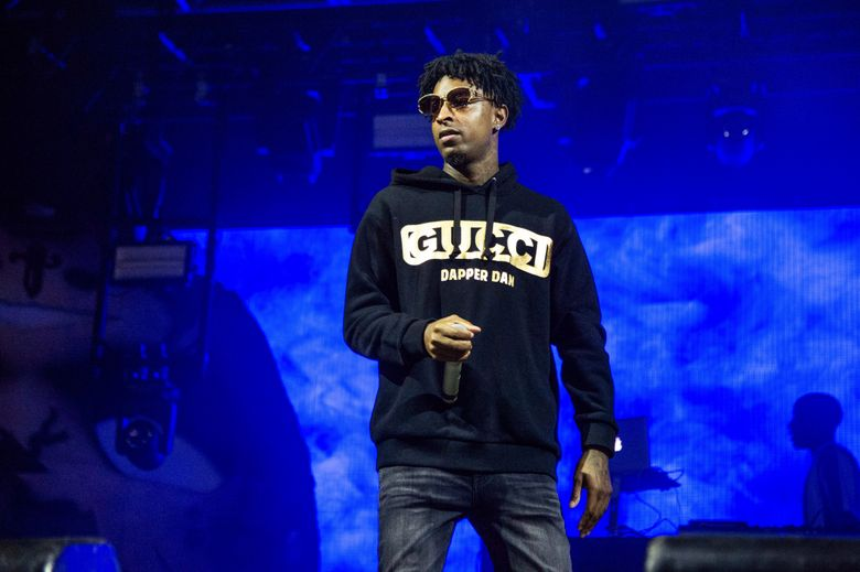 FILE – In this Sunday, Oct. 28, 2018, file photo, 21 Savage performs at the Voodoo Music Experience in City Park in New Orleans. Authorities in Atlanta say Grammy-nominated rapper 21 Savage is in federal immigration custody. U.S. Immigration and Customs Enforcement spokesman Bryan Cox says the artist, whose given name is Sha Yaa Bin Abraham-Joseph, was arrested in a targeted operation early Sunday, Feb. 3, 2019, in the Atlanta area. (Photo by Amy Harris/Invision/AP, File)