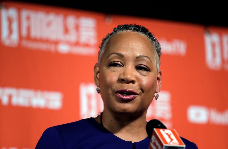 """FILE – In this Sept. 7, 2018, file photo, then WNBA president Lisa Borders addresses media members before Game 1 of the WNBA basketball finals between the Seattle Storm and the Washington Mystics in Seattle. Borders, former president of the WNBA, who was named the head of Time's Up last year, says she has resigned as president and CEO of Time's Up, the gender equality initiative formed in 2018 in response to sexual misconduct allegations in Hollywood. Borders says in statement Monday, Feb. 18, 2019, that she is stepping aside """"with deep regret"""" due to family issues. (AP Photo/Elaine Thompson, File)"""
