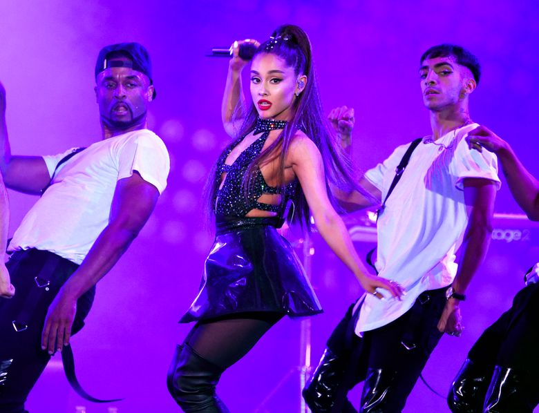 """FILE – In this June 2, 2018 file photo, Ariana Grande, center, performs at Wango Tango in Los Angeles. Grande won her first Grammy Award on Sunday, Feb. 10, but the singer didn't collect it after she decided to skip the ceremony following a public dispute with the show's producer. She won best pop vocal album for """"Sweetener,"""" beating Taylor Swift, Kelly Clarkson, Pink, Shawn Mendes and Camila Cabello in the category. Grande was not in attendance at the pre-telecast ceremony, but she wrote on Twitter that her win was """"wild and beautiful."""" (Photo by Chris Pizzello/Invision/AP, File)"""