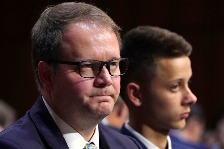 FILE – In this March 14, 2018 file photo, Ryan Petty, left, waits to testify as he sits next to his son Patrick Petty, at a Senate Judiciary Committee hearing on the Parkland, Fla., school shootings and school safety on Capitol Hill in Washington.  Petty and Andrew Pollack, two parents who lost daughters in last year's school shooting are calling for their local newspaper to win the Pulitzer Prize.  They say the South Florida Sun Sentinel has stayed on the story to demand accountability long after the national media left.  (AP Photo/Jacquelyn Martin, File)