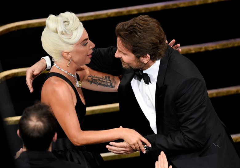 """Bradley Cooper, right, congratulates Lady Gaga in the audience after she is announced winner for best original song for """"Shallow"""" from """"A Star Is Born"""" at the Oscars on Sunday, Feb. 24, 2019, at the Dolby Theatre in Los Angeles. (Photo by Chris Pizzello/Invision/AP)"""