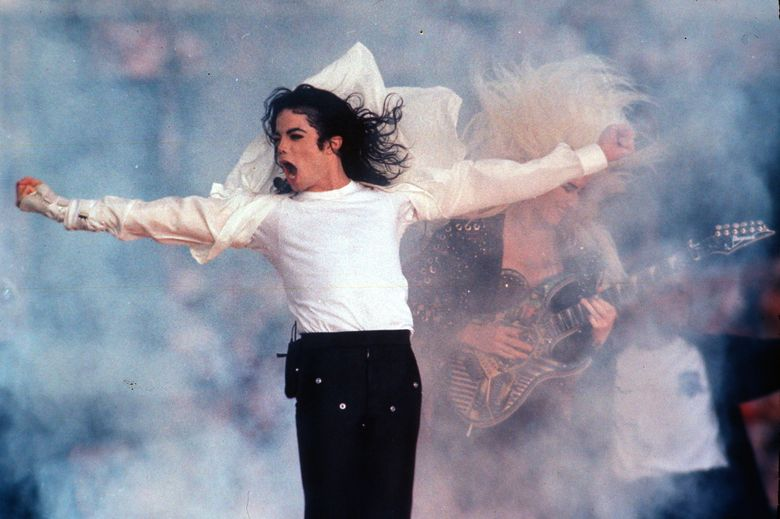 """FILE – This Feb. 1, 1993 file photo shows Pop superstar Michael Jackson performing during the halftime show at the Super Bowl in Pasadena, Calif. A stage musical about Jackson will now skip making its debut in Chicago and instead open Broadway in summer 2020. Producers said Thursday, Feb. 14, 2019, that """"Don't Stop 'Til You Get Enough"""" will no longer have pre-Broadway performances this fall in Chicago, blaming a recent Actors' Equity strike over compensation for developmental labs. (AP Photo/Rusty Kennedy, file)"""