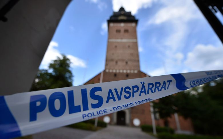 FILE – In this file photo dated Tuesday, July 31, 2018, a police cordon near the scene of a robbery at the Strangnas Cathedral, in Strangnas, Sweden, after  priceless treasures from the Swedish royal regalia were stolen. Swedish broadcaster SVT are reporting Friday Feb. 15, 2019, that the main suspect in the theft of royal funeral artefacts has confessed after his DNA was found on the items that were pulled this month from a garbage bin north of Stockholm.  (Pontus Stenberg/TT News Agency FILE via AP)