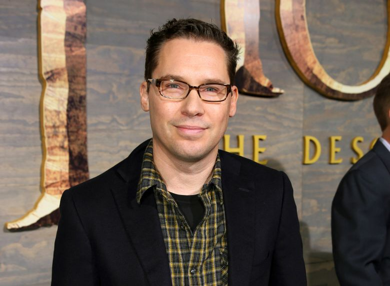 """FILE – This Dec. 2, 2013 file photo shows Bryan Singer at the Los Angeles premiere of """"The Hobbit: The Desolation of Smaug.""""  The British Academy of Film and Television Arts says that it is suspending its nomination of director Bryan Singer amid accusations that he sexually assaulted minors. (Photo by Matt Sayles/Invision/AP, File)"""