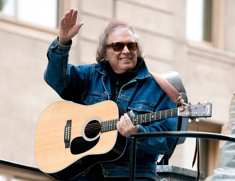 FILE – In this Nov. 22, 2012 file photo, Don McLean rides a float in the Macy's Thanksgiving Day Parade in New York. Don McLean has threatened to sue a weekly newspaper that wrote about his former wife's photo exhibition about domestic abuse, which includes a copy of the protection order issued against him., Friday, Feb. 22, 2019. (AP Photo/Charles Sykes, File)