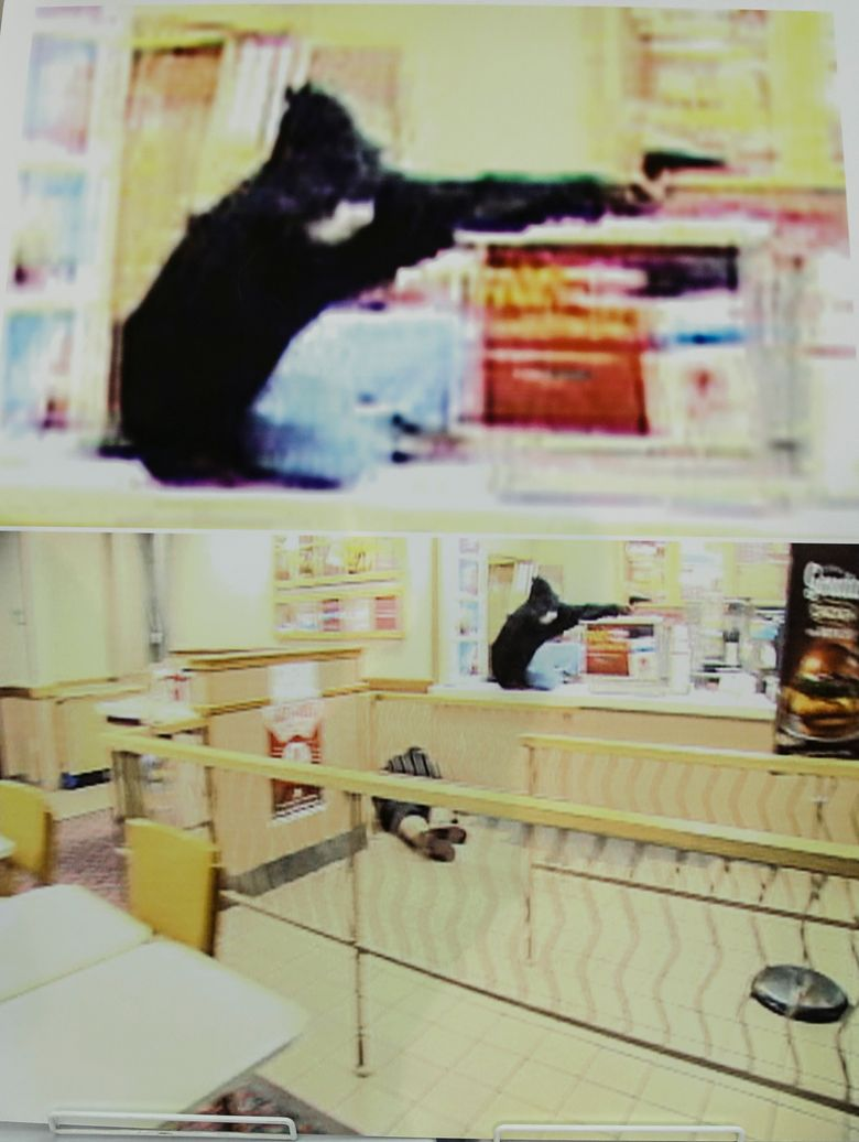 """FILE – In this Aug. 27, 2014 frame grab from security video showing an armed robbery at a Wendy's restaurant in Omaha is displayed during a news conference at police headquarters in Omaha, Neb.  The City of Omaha is on trial in the fatal shooting by police of a television crew member who worked on the law enforcement show """"Cops.""""  Sound technician Bryce Dion was killed in August 2014 when police responded to an armed robbery in an Omaha restaurant. A lawyer for Dion's family said Wednesday, Feb. 20, 2019  that officers fired at robbery suspect Cortez Washington as many as 39 times. One of those bullets inadvertently hit Dion.  (Omaha Police via AP)"""