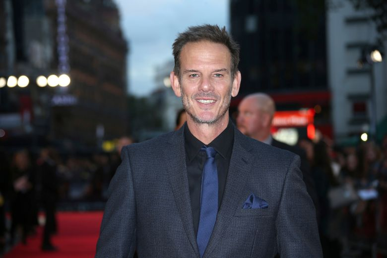 """FILE – In this Sept. 26, 2016 file photo, actor and director Peter Berg poses for photographers upon arrival at the premiere of the film """"Deepwater Horizon"""" in London. Berg directed a new Super Bowl commercial called """"The 100-Year Game"""" that paid homage to past and present NFL players including Tom Brady, Jim Brown, Joe Montana, Dick Butkus, Deion Sanders and Patrick Mahomes. The 2-minute ad will air during Super Bowl 53 on Sunday, Feb. 3, 2019. (Photo by Joel Ryan/Invision/AP, File)"""