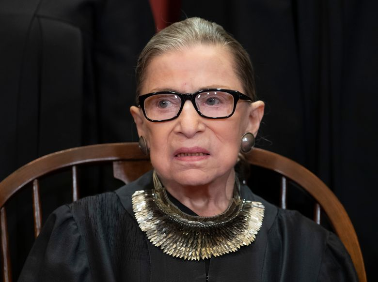 FILE – In this Nov. 30, 2018 file photo, Associate Justice Ruth Bader Ginsburg, nominated by President Bill Clinton, sits with fellow Supreme Court justices for a group portrait at the Supreme Court Building in Washington. Ginsburg is making her first public appearance since undergoing lung cancer surgery in December. The 85-year-old Ginsburg is attending a concert at a museum a few blocks from the White House that is being given by her daughter-in-law and other musicians. Patrice Michaels is married to Ginsburg's son, James. Michaels is a soprano and composer. (AP Photo/J. Scott Applewhite, File)