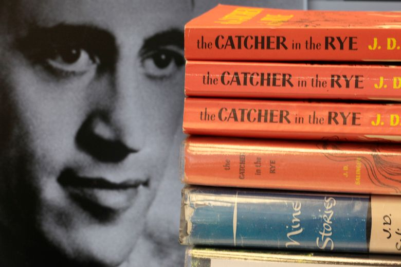 """FILE – This Thursday, Jan. 28, 2010, file photo shows copies of J.D. Salinger's classic novel """"The Catcher in the Rye"""" as well as his volume of short stories called """"Nine Stories"""" at the Orange Public Library in Orange Village, Ohio. In comments which appeared Friday, Feb. 1, 2019 in The Guardian, Matt Salinger, son of the famous author, confirmed longstanding reports that his father had continued to write long after he stopped publishing books and that he and Salinger's widow are """"going as fast as we freaking can"""" to prepare the material for release. (AP Photo/Amy Sancetta, File)"""