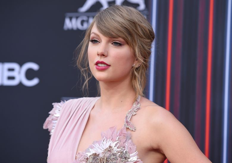 """FILE – In this May 20, 2018 file photo, Taylor Swift arrives at the Billboard Music Awards at the MGM Grand Garden Arena, in Las Vegas. Swift helped a friend and fan propose to his boyfriend. Alex Goldschmidt posted video on Instagram of the surprise as he got engaged to Ross Girard at the Sycamore Tavern in Los Angeles on Saturday, Feb. 23, 2019.  Swift told the crowd Goldschmidt had emailed her and said """"there was a song that was very special to you two called 'King of My Heart.""""' Swift said """"This is from Alex, but sung by me."""" (Photo by Jordan Strauss/Invision/AP, File)"""