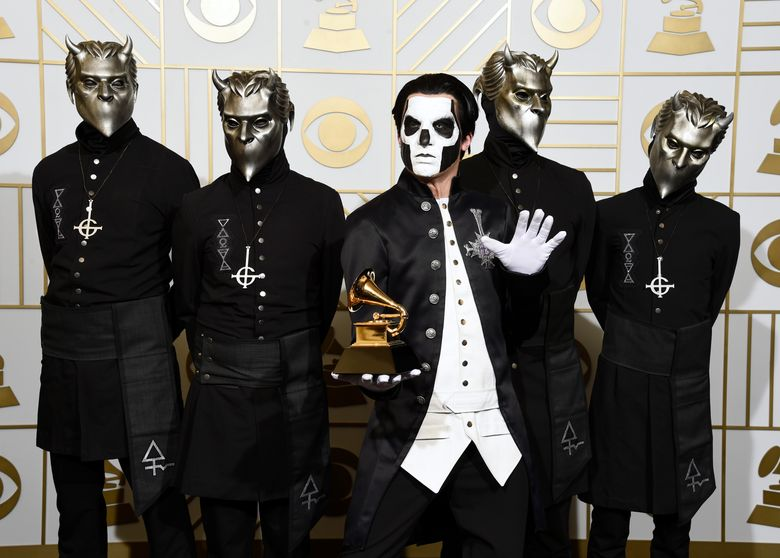 """FILE – In this Feb. 15, 2016 file photo, Ghost poses in the press room with the award for best metal performance for """"Cirice"""" at the 58th annual Grammy Awards in Los Angeles. Ghost is up for best rock album and best rock song at the Grammy Awards on Sunday. (Photo by Chris Pizzello/Invision/AP, File)"""