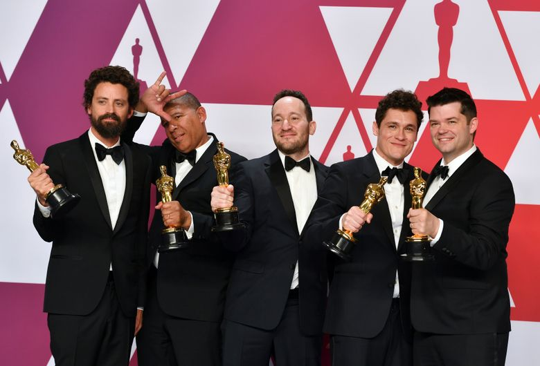 """Bob Persichetti, from left, Peter Ramsey, Rodney Rothman, Phil Lord and Christopher Miller pose with the award for best animated feature film for """"Spider-Man: Into the Spider-Verse"""" in the press room at the Oscars on Sunday, Feb. 24, 2019, at the Dolby Theatre in Los Angeles. (Photo by Jordan Strauss/Invision/AP)"""