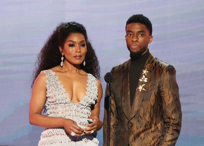 """FILE – In this Jan. 27, 2019, file photo, Angela Bassett, left, and Chadwick Boseman, nominated for outstanding performance by a cast in a motion picture, introduce a clip from their film """"Black Panther"""" at the 25th annual Screen Actors Guild Awards at the Shrine Auditorium & Expo Hall in Los Angeles. Boseman and Bassett have been added to the starry list of presenters for the 91st Oscars. (Photo by Richard Shotwell/Invision/AP, File)"""