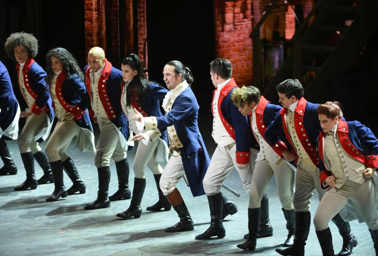 """Lin-Manuel Miranda, center, and the cast of """"Hamilton"""" perform at the Tony Awards in New York in 2016. Many academics argue the onstage portrait of Alexander Hamilton is a counterfeit. (Photo by Evan Agostini/Invision/AP, File)"""