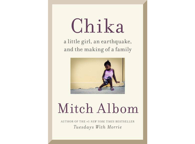 """This cover image released by Harper shows """"Chika: A Little Girl, An Earthquake, and the Making of a Family,"""" by Mitch Albom. The title refers to a girl born days before the 2010 earthquake in Haiti. Albom and his wife  brought Chika to their home in Detroit after she was diagnosed at age 5 with a brain tumor. The book tells of their two-year journey to find treatment before Chika died in 2017, at age 7. Harper announced Tuesday that Albom's """"Chika"""" comes out in November. (Harper via AP)"""