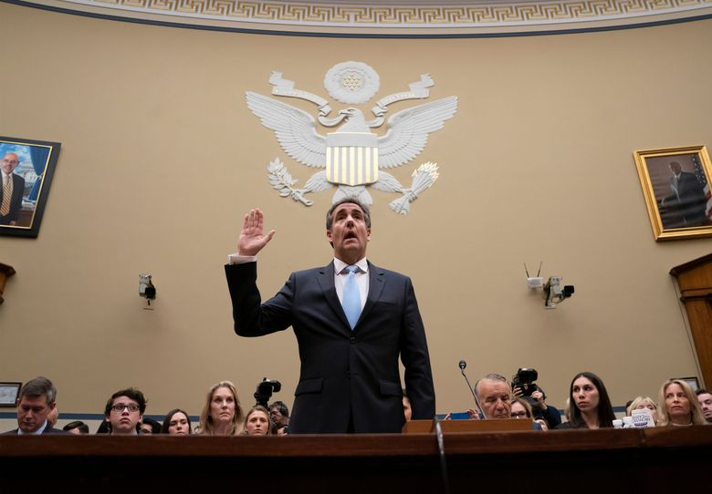 FILE- In this Feb. 27, 2019 file photo, Michael Cohen, President Donald Trump's former personal lawyer, is sworn in to testify before the House Oversight and Reform Committee on Capitol Hill in Washington. Giving Congress a who's who of President Donald Trump's allies and business associates during his testimony, Cohen rattled off more than a dozen names, providing the committee with a potential roadmap for future hearings. (AP Photo/J. Scott Applewhite, File)