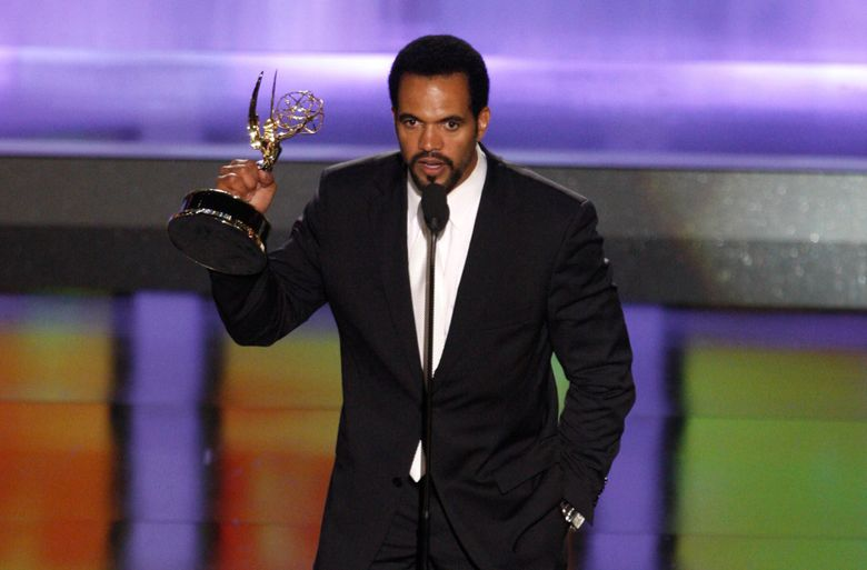 """FILE- In this June 20, 2008, file photo Kristoff St. John accepts the award for outstanding supporting actor in a drama series for his work on """"The Young and the Restless"""" at the 35th Annual Daytime Emmy Awards in Los Angeles.  The """"Young and the Restless"""" is remembering St. John with a series of special episodes. The CBS soap opera on Friday, Feb. 8, 2019, will broadcast a special tribute to the actor.  The 52-year-old died Sunday at his home in Los Angeles.   (AP Photo/Matt Sayles, File)"""