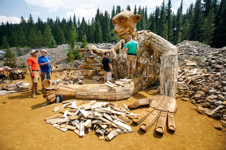 FILE – In this Aug. 7, 2018, photo, a 15-foot-high troll sculpture is under construction along a trail in Breckenridge, Colo. It became so popular that nearby homeowners complained about all the foot traffic, so it was taken down in November. On Friday, Feb. 22, 2019, Breckenridge officials announced they had reached a deal with Danish artist Thomas Dambo to rebuild the troll this spring. The location hasn't been decided. (Hugh Carey/Summit Daily News via AP, File)