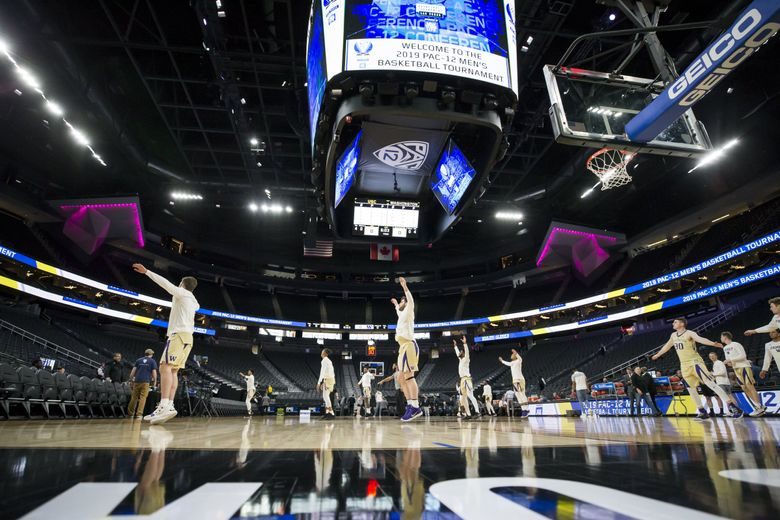 Players warm up before the Washington Huskies take on the USC Trojans for the quarterfinals of the Pac-12 Tournament at T-Mobile Arena in Las Vegas, Nevada Thursday March 14, 2019. (Bettina Hansen / The Seattle Times)