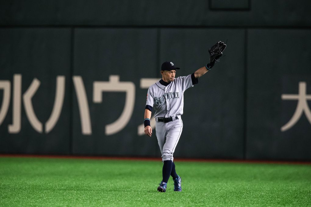 Mariners right fielder Ichiro leaves Thursday's game in the eighth inning to thunderous applause in the Tokyo Dome. (Dean Rutz / The Seattle Times)