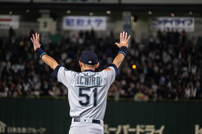 After announcing his retirement to Seattle media in a small news conference, Ichiro returns to the Tokyo Dome turf to take a victory lap and salute the fans. (Dean Rutz / The Seattle Times)