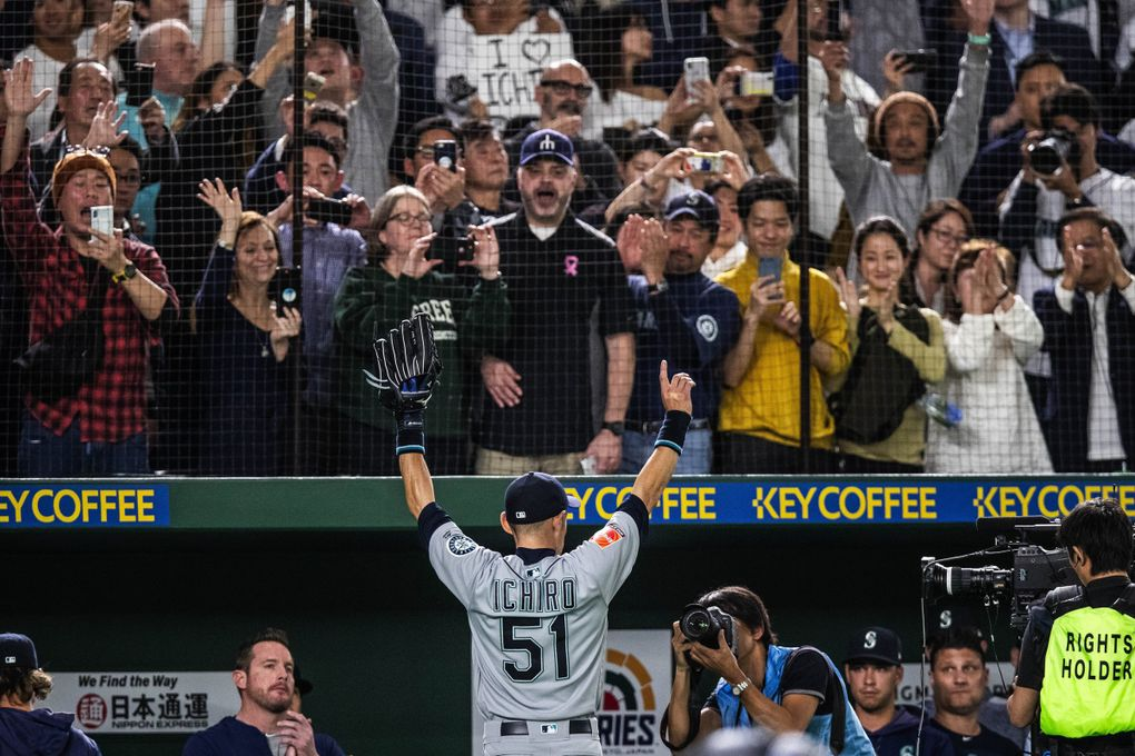Ichiro's curtain call comes in the eighth inning, pulled to a standing ovation in the Tokyo Dome. Word spread during Thursday's game against the A's that Ichiro would retire after the game, ending a 28-year professional baseball career. (Dean Rutz / The Seattle Times)