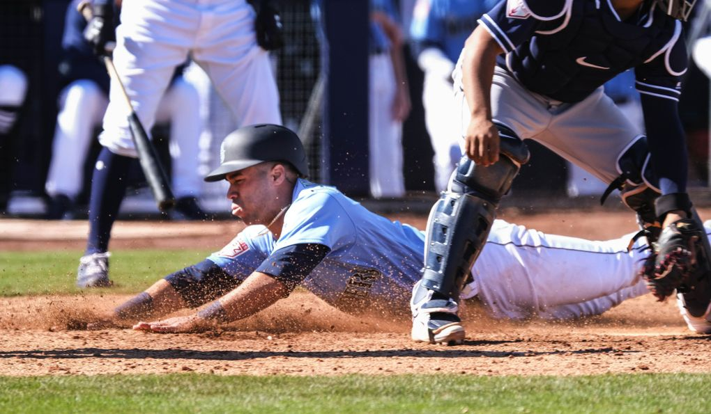 Dom Thompson-Williams scores from third in spring training Feb. 23 in Peoria, Arizona. (Dean Rutz / The Seattle Times)