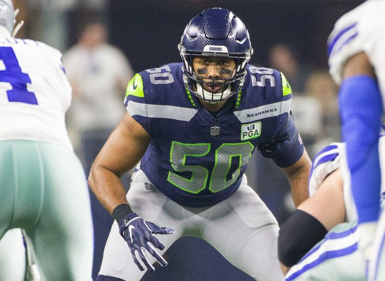 Seattle Seahawks outside linebacker K.J. Wright (50) lines up against the Dallas Cowboys. (Mike Siegel / The Seattle Times)